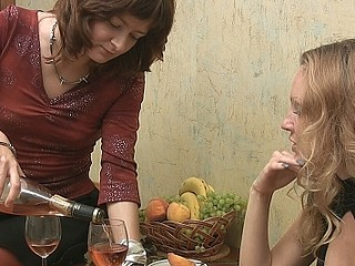 Two cuties swallow wine and talk