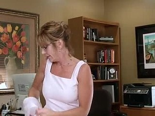Sexy cougar secretary plays with a pink sex toy on break
