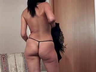 Exotic anilos nelly removes her dark corset and lounges in her chair