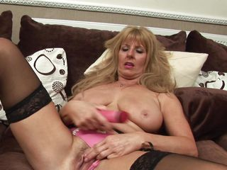 nasty blond lady playing with a dildo