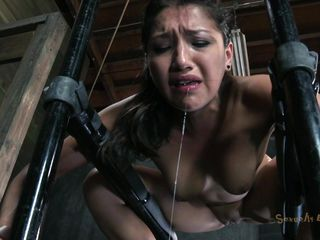 Positioned on a metal structure and bound with chains the lovely brunette Vicki is being mouth fucked by a guy. Her ass is damn hot and that pretty mouth of hers begs for schlong and cum! The dude shows her no leniency and stick his dick unfathomable in her throat making her gag. That shaved cookie could use the same treatment
