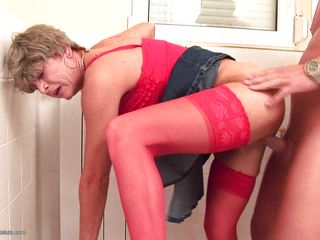 She likes that big hard shaved dick, so much that she moans with pleasure as the guy goes deep in her cunt, fucking this mature bitch near the toilet seat. Watch her getting fucked by the stud while he sits on the toilet, she enjoys each inch of penis penetrating her. Does this whore merits some goo in her pussy?