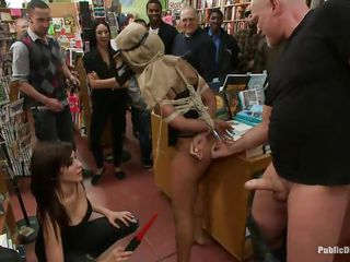 Leilani Leeane is a hot black sex slave craving for cock. She likes being humiliated in public places, like this nice book store. She has a bag covering her face and her hands tied together with ropes around her back. Princess Donna and Mark are taking advantage of that hot brunette and gave her a valuable hard fuck.