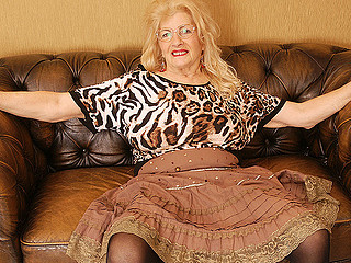 Actually old blonde lady is showing off her fine and very huge love bubbles