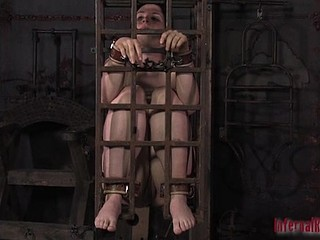 Gagged doxy in cage gets some painful orgasm
