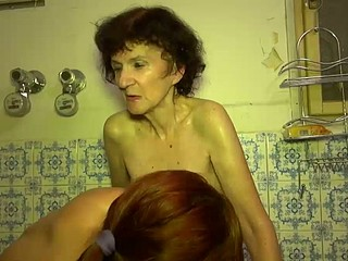 Old Granny playing with juvenile sexy beauty in washroom
