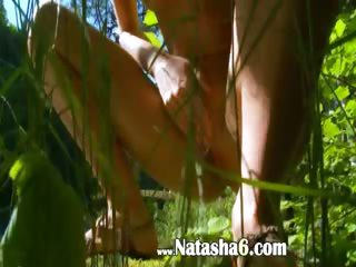 Petite latvian honey peeing in a forest