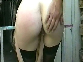 Milf slave with large tits gets naked and spanked on her pussy