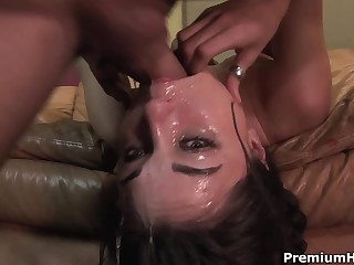 Well known dark-haired haired porn diva Sasha Grey gets her throat fucked extremely deep. She gets a mouthful of spunk after rough face fucking on the couch.