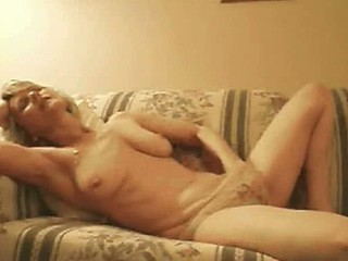 Golden-haired mature masturbating