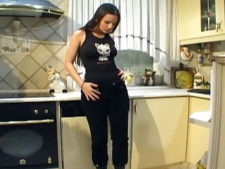 Breasty sweetheart with leather boots masturbates in the kitchen