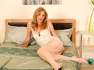 Leggy golden-haired cougar fucks herself with a huge sex tool
