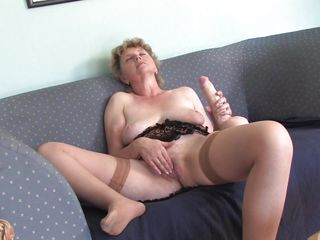 slutty grandma masturbating with a large dildo