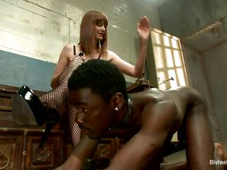 Alyssah Simone is a red head bitch who wants to punish this submissive black chaps for not following her orders. This babe puts a collar on his neck and swanks his ass. This babe makes him take off her heels and wants him to lick her pink cunt so she can enjoy his humiliation.