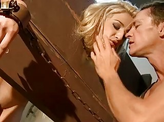 Blonde slave gets banged from behind