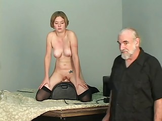 Short-haired b-cup golden-haired lowers her pussy onto mechanical sex tool