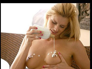 Darryl Hanah plays with sexy lotion on her pleasant naturally large boobs