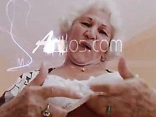 Big titted grandma plays with her mangos and her old cunt
