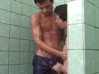 2 gays shower and eat cock before he acquires his ass plugged