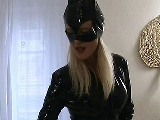 Cat woman comes over and blows him and gives him a footjob