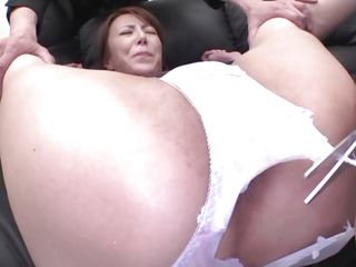 Now here's a concept that works! A horny asian milf secured with a bondage device appears to be not acquiesce what's going to happen with her large booty. But after the man cuts her pants with scissors and inserts his finger in her tight shaved anal opening that babe suddenly starts moaning and enjoys the treatment.