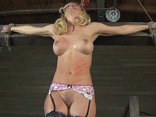 Fastened up beauty gets tongue and facial punishment