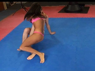 Melanie Memphis wrestles her slave to the ground