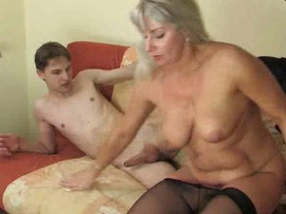 Young man enjoying a horny aged woman