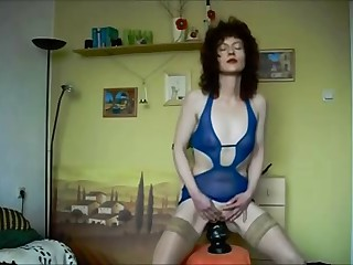 Mature Brunette Stuffs Her Pussy With Huge Buttplug
