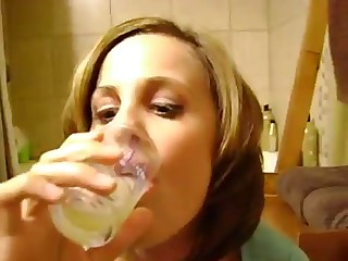 Amateur Wench Drinking a Glass of Cum