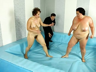 Raunchy adult wrestling between 2 BBWs