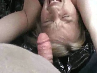 Older German blonde bitch is getting drilled by two guys, and she is doing it outdoors while one of those chaps films her and gives her a priceless facial.