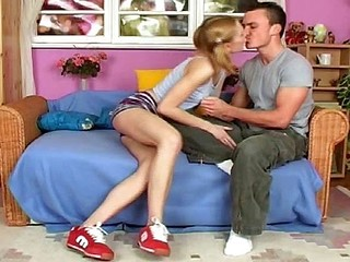 Sweet young blonde in pigtails munches on his fuck tool and gets nailed