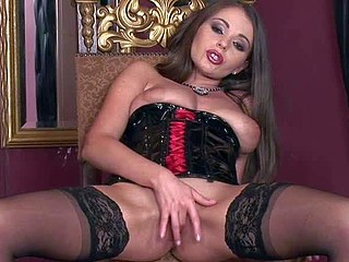 Gorgeous brunette Zara in black nylon nylons and corset shows