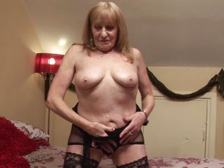 aged lady playing with her sex toy