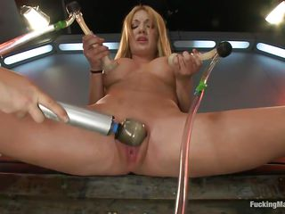 Amy Brooke is a golden-haired gorgeous milf who enjoys pleasuring herself. This babe groans with both pang and pleasure while she vacuums her big tits. For more pleasure a friend comes in and begins rubbing her shaved pussy. After that, a fucking machine begins fucking on her snatch, making her scream.
