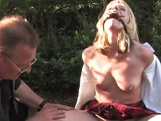 Kinky naughty chick acquires drilled by two men in throat