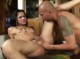Slender lady-man plays with cock