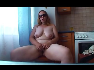 Dilettante chubby redhead plays on cam