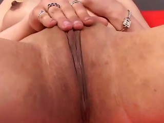 Big-Titted gal masturbating using her fingers inside her beaver
