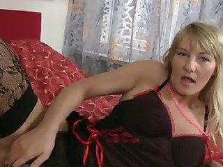 Sexy blonde cougar round giant natural pantoons gets naked off her lingerie and gives her  hairy wet crack the great fucking close to the fake penis
