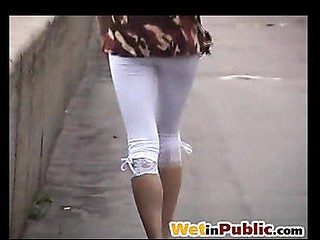 Sexy wench in leggings wetting herself