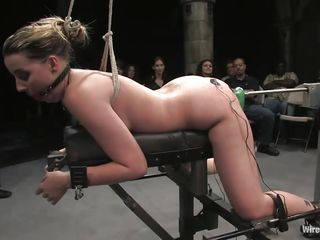 Delilah Strong is a blonde milf with small natural tits who enjoys being machine fucked in front of people. The brunette femdom-goddess with huge tits makes sure she gets what she had been waiting for. The gorgeous girl tied up in ropes loves when people are watching her pussy getting roughly penetrated.