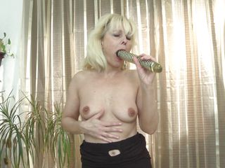 Look at this mature mom how that babe is loosing control. This blonde lady has found a huge sex-toy beside her and utilizing it fully by thinking it a huge dick. She is sucking this huge sex-toy again and again and then that babe is rubbing her pussy to make it soaked so that that babe can insert in without any complication.