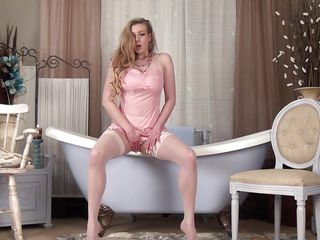 Look at that healthy body this babe has, large natural breasts, long sexy legs, blond hair, hot ass and a pink shaved pussy that begs for a large dick in it. She is horny and after that babe takes off her pants this slut squeezes her hot boobs and then shows us her vagina. Is that babe going to finger herself in that pink pussy and tight asshole?