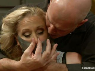 Mature blond Julia needs to learn smth about obedience. Here that babe is in the kitchen, cooking the meal when a muscled bald dude grabs her and ties the floozy with duct tape, face hole folding her too. He puts the blond cunt on the floor, removes the duct tape from her face hole and begins fucking her throat deeply