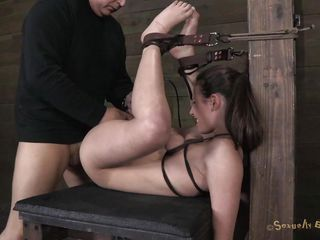 She's tied with leather belts and her legs are positioned up. Her name is Casey and boy this chick has a hot booty and a shaved cunt that's juicy and ready for smth hard inside it. The executor fingers Casey hard but he has to hurry, another bitch awaits his special treatments while being tied up