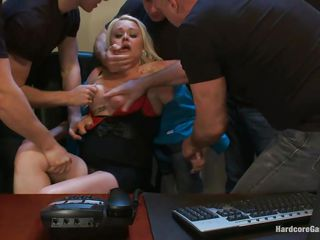 With guns in front of her face the blonde milf gets scared and obeys these guys. They want to use her body so they grab the slut, lay her on the desk and spread her thighs. One of the men begins fucking her hairless love tunnel and other her face hole while the others keep her down. Will she learn to like it?