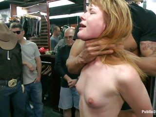 Slutty redhead Claire enjoys being abased in public. She sits on her knees with a vibrator on her cunt and is waiting for greater quantity commands from the people who are watching her. A strong men makes her throat engulf his big hard dick, then puts her on a chair and starts fucking that wet pussy. Check it out!