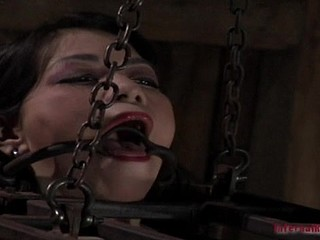 Badly behaved sex Asian chick has been put in the diminutive cage with mouth shut